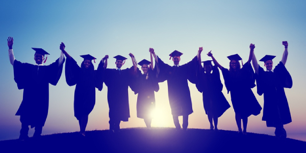 A Group Of Graduates Raising Hands In The Resemblence Of Their Graduation Success.