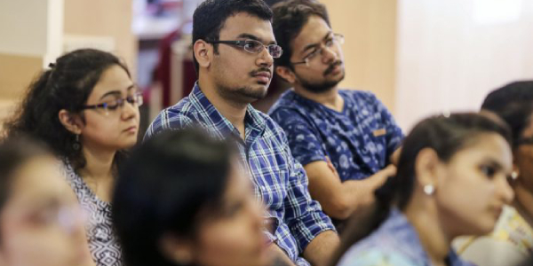 Group Of IIM And IIT Students Listening A Lecture In Classroom.