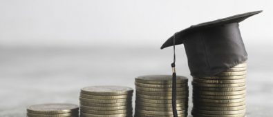 A Graduation Hat Placed Over The Coins.