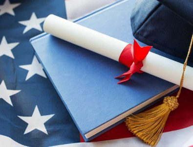 Close Up Of Bachelor Hat And Diploma On American Flag