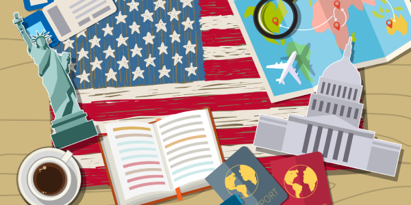 A Table Full Of USA Flag, Books & Coffee - Representing The Higher Education In The USA.