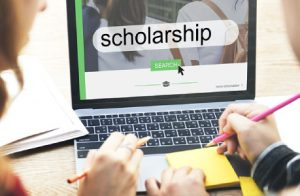 Two Persons Searching About Scholarship Websites Over Internet.
