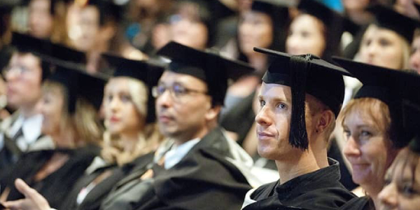 Group Of Abroad Students In Their Graduation Ceremony.