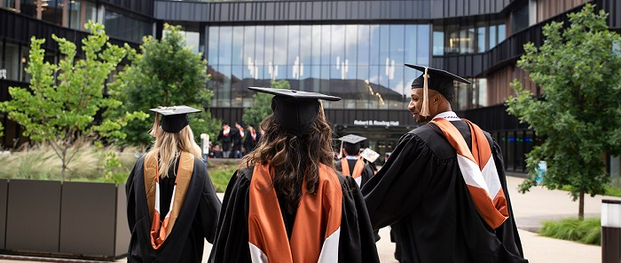 Canadian Students Dressed In Academic Dress With Graduate Cap Over Their Head.